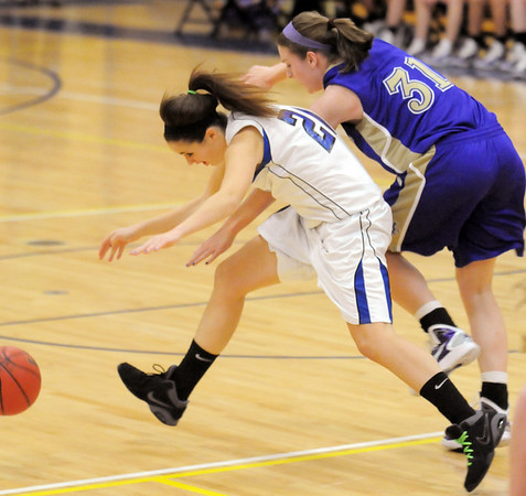 BE1223HBAS02<br /> Kassandra Johannsen, Holy Family collides with Antonia Land, Wheatridge during Friday's game at Wheatridge.<br /> December 17, 2010<br /> staff photo/David R. Jennings