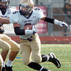Holy Family's Jarred Deherrera carries the ball against Windsor during Saturday's first round state 3A playoff game at H. J. Dudley Field in Windsor.<br /> <br /> November 11, 2011<br /> staff photo/ David R. Jennings
