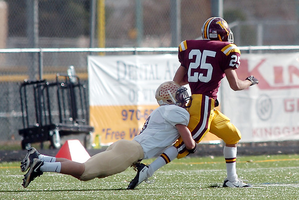 Holy Family's Jake Balthazor tackles Windsor's Vince Hooley during Saturday's first round state 3A playoff game at H. J. Dudley Field in Windsor.<br /> <br /> November 11, 2011<br /> staff photo/ David R. Jennings