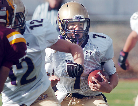 Holy Family's quarterback David Sommers rusn the ball against Windsor during Saturday's first round state 3A playoff game at H. J. Dudley Field in Windsor.<br /> <br /> November 11, 2011<br /> staff photo/ David R. Jennings