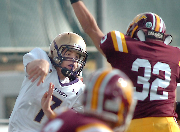 Holy Family's Quarterback David Sommers passes the ball over  Windsor's Lucas Watts during Saturday's first round state 3A playoff game at H. J. Dudley Field in Windsor.<br /> <br /> November 11, 2011<br /> staff photo/ David R. Jennings