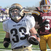 Holy Family's Connor Clay carries the ball into the end zone past Windsor's Joe Sanger during Saturday's first round state 3A playoff game at H. J. Dudley Field in Windsor.<br /> <br /> November 11, 2011<br /> staff photo/ David R. Jennings