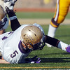 Holy Family's Jarred Deherrera reaches to help recover a Windsor fumble during Saturday's first round state 3A playoff game at H. J. Dudley Field in Windsor.<br /> <br /> November 11, 2011<br /> staff photo/ David R. Jennings