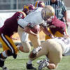 Holy Family's Jake Balthazor carries the ball against Windsor's Sean Glenn's tackle during Saturday's first round state 3A playoff game at H. J. Dudley Field in Windsor.<br /> <br /> November 11, 2011<br /> staff photo/ David R. Jennings