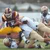 A host of Holy Family players tackle Windsor's Joe Sanger during Saturday's first round state 3A playoff game at H. J. Dudley Field in Windsor.<br /> <br /> November 11, 2011<br /> staff photo/ David R. Jennings