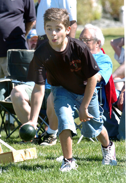 Enzo Elliott, 11, takes aim as hethrows a bocce ball during Saturday's Bocce tournament at Holy Family High School .<br /> <br /> September 25, 2010<br /> staff photo/David R. Jennings