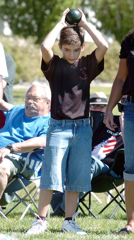 Enzo Elliott, 11, holds a bocce ball over his head while waiting his turn in Saturday's Bocce tournament at Holy Family High School .<br /> <br /> September 25, 2010<br /> staff photo/David R. Jennings