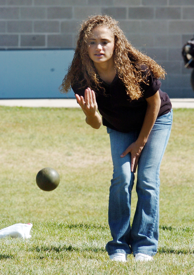 Amanda Welder takes careful aim with a bocce ball while competing in Saturday's Bocce tournament for Holy Family High School .<br /> <br /> September 25, 2010<br /> staff photo/David R. Jennings