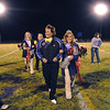 Holy Family's homecoming king and queen, Kathleen Gerry, standing in for her son Jonathon Gerry, escorts Taylor Balthazor after the halftime ceremony of Friday's homecoming game against The Pinnacle at Mike G. Gabriel Stadium.<br /> October 16, 2009<br /> Staff photo/David R. Jennings