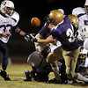 Duncan Yost, Holy Family, fumbles the ball but was recovered by Family's Matthew Miller,  during Friday's homecoming game against The Pinnacle at Mike G. Gabriel Stadium.<br /> October 16, 2009<br /> Staff photo/David R. Jennings