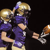Holy Family's Austin Maul, left, congradulates Scout Cox after he intecepted a pass and made a touchdown against The Pinnacle  during Friday's homecoming game at Mike G. Gabriel Stadium.<br /> October 16, 2009<br /> Staff photo/David R. Jennings
