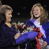 Taylor Balthazor, right, Holy Family's 2009 homecoming queen, waits to be crowned by Anna Marie Piccone Coffey, the 1959 homecoming queen during halftime of Friday's homecoming game against The Pinnacle at Mike G. Gabriel Stadium.<br /> October 16, 2009<br /> Staff photo/David R. Jennings