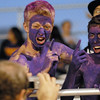 Holy Family fans Seanus Quinn, left, and Tyler Kriegercheer to a camera during  Friday's homecoming game against The Pinnacle at Mike G. Gabriel Stadium.<br /> October 16, 2009<br /> Staff photo/David R. Jennings