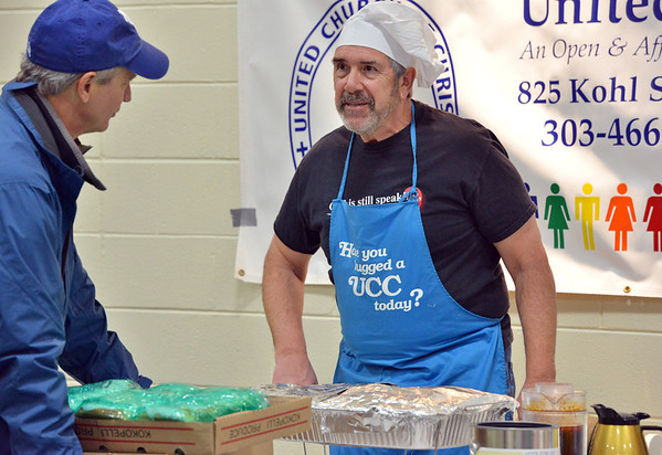 Rev. Greg Garland, left,  of the United Church of Broomfield, chats with Rev. Pete Terpenning, pastor of Community United Church of Christ, during  the Holy Smokes Clergy Cook-Off fundraiser for Flatirons Habitat for Humanity at the Broomfield United Methodist Church on Saturday. <br /> November 10, 2012<br /> staff photo/ David R. Jennings