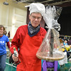 Father Ted Howard of St. John's Episcopal Church carries his trophy and prize for winning the People's choice award during the Holy Smokes Clergy Cook-Off fundraiser for Flatirons Habitat for Humanity at the Broomfield United Methodist Church on Saturday. <br /> November 10, 2012<br /> staff photo/ David R. Jennings