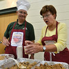 Stan Adamson, left, pastor of St. Andrew Presbyterian church, listens as Anna Wilkinson explains the native Polish recipe of BIGOS From Leftover Roast during the Holy Smokes Clergy Cook-Off fundraiser for Flatirons Habitat for Humanity at the Broomfield United Methodist Church on Saturday. <br /> November 10, 2012<br /> staff photo/ David R. Jennings