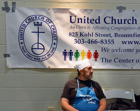 United Church of Broomfield pastor Greg Garland waits to serve his recipe of Korean Mandu during the Holy Smokes Clergy Cook-Off fundraiser for Flatirons Habitat for Humanity at the Broomfield United Methodist Church on Saturday. <br /> November 10, 2012<br /> staff photo/ David R. Jennings