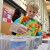Max Hancock, 8, helps prepare Korean Mandu for the United Church of Broomfield during the Holy Smokes Clergy Cook-Off fundraiser for Flatirons Habitat for Humanity at the Broomfield United Methodist Church on Saturday. <br /> November 10, 2012<br /> staff photo/ David R. Jennings
