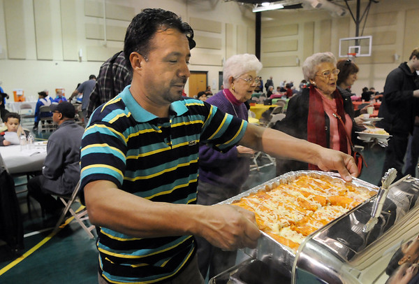 Jesus Alcantar puts a tray of enchiladas in a warmer at the 5th Annual Holy Smokes Clergy Cook-off benefiting Flatirons Habitat For Humanity at the Broomfield United Methodist Church on Saturday. <br /> <br /> February 6, 2010<br /> Staff photo/David R. Jennings