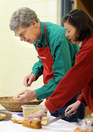 """Ted Howard, left, with St. John's Episcopal Church in Boulder, and Lisa Gills prepare his dish of """"Ted's Tasty Green Olive Tapenade"""" at the 5th Annual Holy Smokes Clergy Cook-off benefiting Flatirons Habitat For Humanity at the Broomfield United Methodist Church on Saturday.<br /> <br /> February 6, 2010<br /> Staff photo/David R. Jennings"""