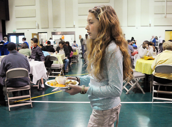 Victoria Tucker, 11, carries her plate of food to a table at the 5th Annual Holy Smokes Clergy Cook-off benefiting Flatirons Habitat For Humanity at the Broomfield United Methodist Church on Saturday.<br /> <br /> February 6, 2010<br /> Staff photo/David R. Jennings