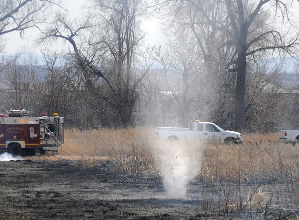 A small whilrwind dances through the burned area of North Metro Fire Rescue District's controlled burn of 20 acres on the City and County fo Broomfeild's Hoopes Farm at Lowell Blvd. and 144th Ave. on Wednesday. <br /> <br /> <br /> March 17, 2010<br /> Staff photo/David R. Jennings