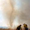 A whirlwind created by the fire swirls as North Metro Fire Rescue District firefighters work the controlled burn of 20 acres  on the City and County of Broomfield's Hoopes Farm at Lowell Blvd. and 144th Ave. on Wednesday. The burn was not only a training session for North Metro Wildland Team but also is being used as a weed control and study by the county.<br /> <br /> <br /> March 17, 2010<br /> Staff photo/David R. Jennings