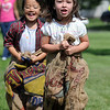 Isabelle Zuniga, 3 1/2, right, and Lily Kasic, 5, in the sack race at the Broomfield Optimist Club's Huck Finn-Becky Thatcher Fishing Derby on Saturday at the Trails Pond. <br /> <br /> August 29, 2009<br /> staff photo/David R. Jennings