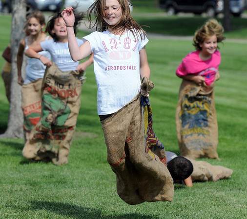 Mikayla Goodman, 11, leads the pack during the sack race at the Broomfield Optimist Club's Huck Finn-Becky Thatcher Fishing Derby on Saturday at the Trails Pond. <br /> <br /> August 29, 2009<br /> staff photo/David R. Jennings