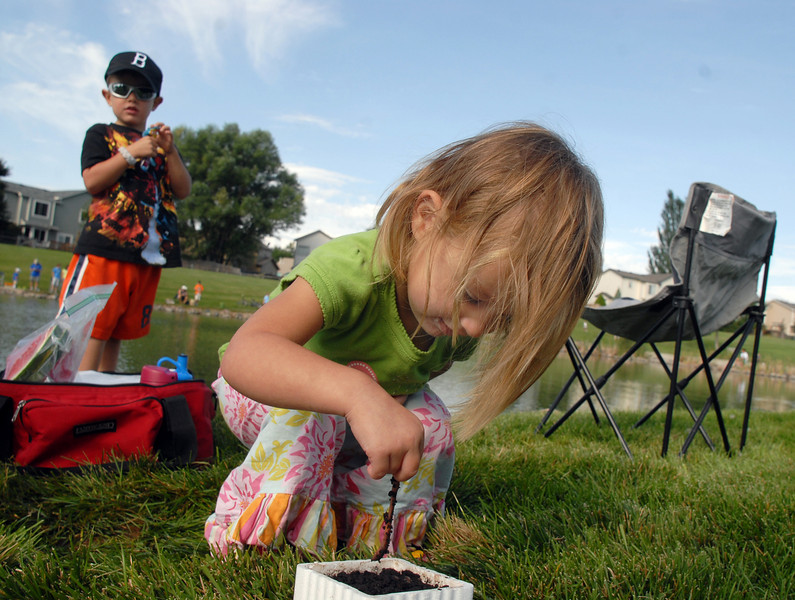 Elle Gray, 2, picks up worms for her brother Camden, 5, left, during the Broomfield Optimist Club's Huck Finn-Becky Thatcher Fishing Derby on Saturday at the Trails Pond. <br /> <br /> August 29, 2009<br /> staff photo/David R. Jennings