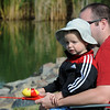 Teige Green, 2 1/2, and his father Brad fish during the Broomfield Optimist Club's Huck Finn-Becky Thatcher Fishing Derby on Saturday at the Trails Pond. <br /> <br /> August 29, 2009<br /> staff photo/David R. Jennings