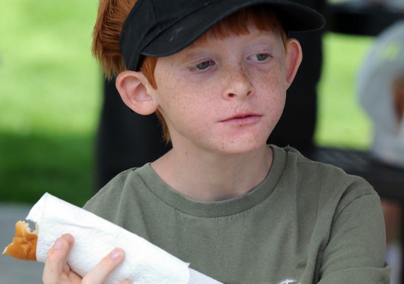 Brad Howell, 9, eats a hot dog at the Broomfield Optimist Club's Huck Finn-Becky Thatcher Fishing Derby on Saturday at the Trails Pond. <br /> <br /> August 29, 2009<br /> staff photo/David R. Jennings