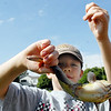 Jack Thompson, 7, holds the fish he caught at the Broomfield Optimist Club's Huck Finn-Becky Thatcher Fishing Derby on Saturday at the Trails Pond. <br /> <br /> August 29, 2009<br /> staff photo/David R. Jennings