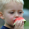 Preston Weine, 3, cools off by eating a watermelon at the Broomfield Optimist Club's Huck Finn-Becky Thatcher Fishing Derby on Saturday at the Trails Pond. <br /> <br /> August 29, 2009<br /> staff photo/David R. Jennings