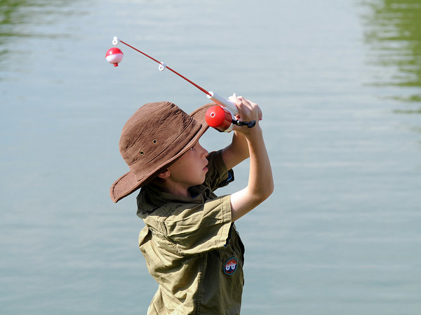 Eldon McClure, 7, casts his pole at the Broomfield Optimist Club's Huck Finn-Becky Thatcher Fishing Derby on Saturday at the Trails Pond. <br /> <br /> August 29, 2009<br /> staff photo/David R. Jennings