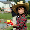Lily Kasic, 5, dressed up in the Huck Finn and Becky Thatcher  theme for the Broomfield Optimist Club's Huck Finn-Becky Thatcher Fishing Derby on Saturday at the Trails Pond. <br /> <br /> August 29, 2009<br /> staff photo/David R. Jennings