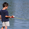 Matthew Williams, 4, watches his fishing line at the Broomfield Optimist Club's Huck Finn-Becky Thatcher Fishing Derby on Saturday at the Trails Pond. <br /> <br /> August 29, 2009<br /> staff photo/David R. Jennings