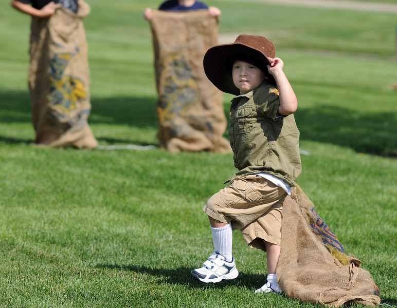 Graham McClure, 3, heads to the sack race at the Broomfield Optimist Club's Huck Finn-Becky Thatcher Fishing Derby on Saturday at the Trails Pond. <br /> <br /> August 29, 2009<br /> staff photo/David R. Jennings
