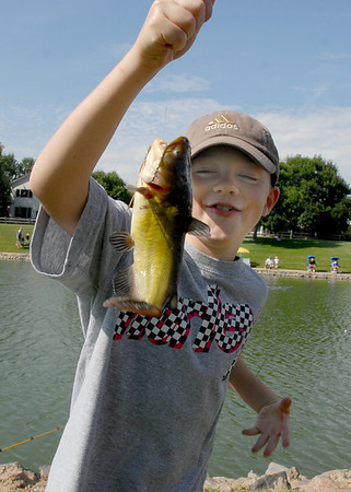 Jack Thompson, 7, holds a fish he just caught at the Broomfield Optimist Club's Huck Finn-Becky Thatcher Fishing Derby on Saturday at the Trails Pond. <br /> <br /> August 29, 2009<br /> staff photo/David R. Jennings
