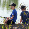 Ethan Wagner, 8, left, fishes with his brother Rowan, 6, at the Broomfield Optimist Club's Huck Finn-Becky Thatcher Fishing Derby on Saturday at the Trails Pond. <br /> <br /> August 29, 2009<br /> staff photo/David R. Jennings