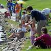 Over 120 people  lined the shores of Trails Pond to try their luck a fishing during the Broomfield Optimist Club's Huck Finn-Becky Thatcher Fishing Derby on Saturday at the Trails Pond. <br /> <br /> August 29, 2009<br /> staff photo/David R. Jennings