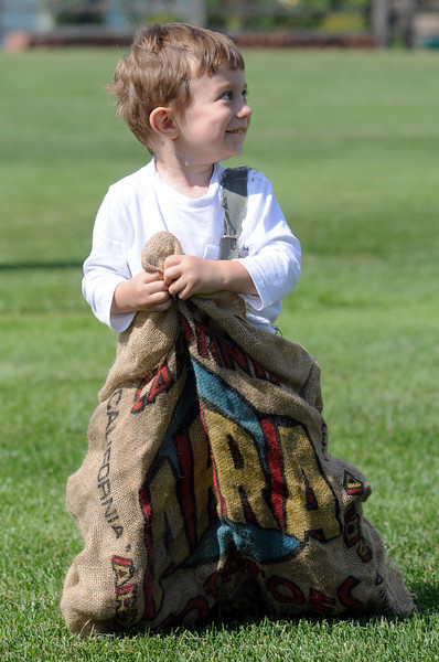Nathan Heller, 2 1/2, tries his best in the sack  at the Broomfield Optimist Club's Huck Finn-Becky Thatcher Fishing Derby on Saturday at the Trails Pond. <br /> <br /> August 29, 2009<br /> staff photo/David R. Jennings