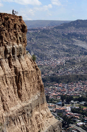 Slovakia's downhill mountain bike champion Filip Polc is seen on the edge of a cliff as he trains on the outskirts of La Paz, Friday, April 9, 2010. Polc is training in Bolivia's altitude ahead of competing in international mountain biking competitions. (AP Photo/Juan Karita)