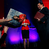 Sarah Palin is seen both on her book cover and live on stage after she spoke at the Southern  Republican Leadership Conference in New Orleans, Friday, April 9, 2010. (AP Photo/Gerald Herbert)