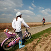 A member of the BMC Racing Team, right, is seen during a training session ahead of Sunday's108th edition of the Paris-Roubaix cycling classic, in Cysoing , northern France, Friday April 9, 2010. The 259 kilometers (miles 160.93) long race involved 52.9 kilometers (miles 32.87) of strenuous highly-feared cobblestone-paved roads. (AP Photo/Thibault Vandermersch).