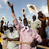 Supporters of Southern Sudan President and elections candidate  Salva Kiir cheer as he arrives at the last election rally in Juba, Southern Sudan,  Friday April 9, 2010.  The people of Southern Sudan will cast ballots in a national election for the first time in more than two decades when a three-day election begins Sunday. Despite the first-in-a-generation vote, most people are already looking past the elections to a vote next January considered far more significant: a referendum on independence that could signal the birth of a new African nation, if final negotiations with Khartoum over oil rights and the location of the border are worked out peacefully. (AP Photo/Jerome Delay)