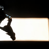 A man walks through a shaft of sun light at Atocha train station in Madrid, Friday, April 9, 2010. (AP Photo/Steffi Loos)