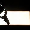 A man walks through a shaft of sun light at Atocha train station in Madrid, Friday, April 9, 2010. (AP Photo/Steffi Loos)