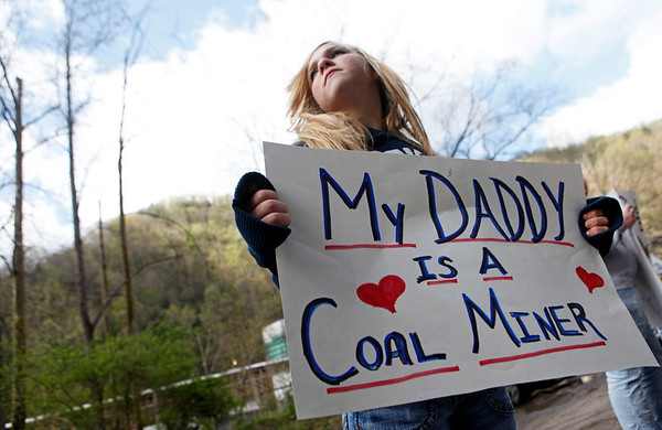 Brianna Bailey, 14, holds a sign showing her support for coal miners near the entrance of the Upper Big Branch Mine, Friday, April 9, 2010, in Montcoal, W. Va. (AP Photo/Haraz N. Ghanbari)