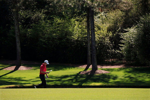 Mike Weir of Canada checks his course notes as he walks down the 13th fairway during the second round of the Masters golf tournament in Augusta, Ga., Friday, April 9, 2010. (AP Photo/Charlie Riedel)